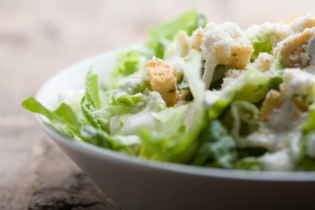 Ceasar Salad with dressing and parmesan