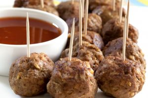Meatball appetizers, with a dipping sauce.